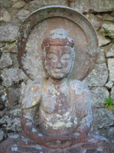 Ancient stone Buddha on Mount Yoshida, Kyoto;