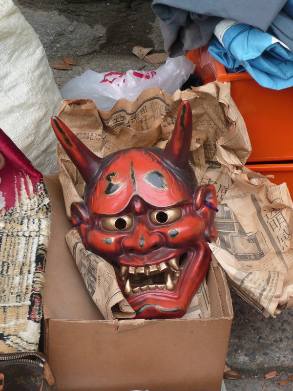 Oni devil mask at a Kyoto temple market;